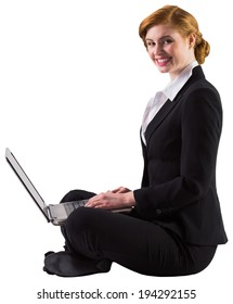 Redhead businesswoman using her laptop on white background