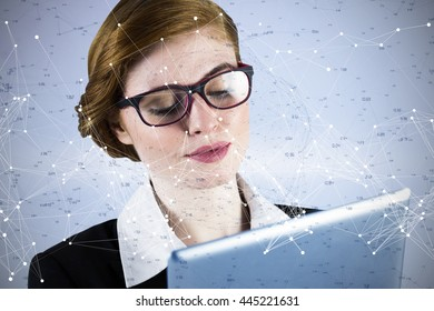 Redhead businesswoman using her tablet pc against constellation of stars