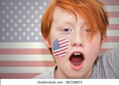 redhead fan boy with american flag painted on his face.
