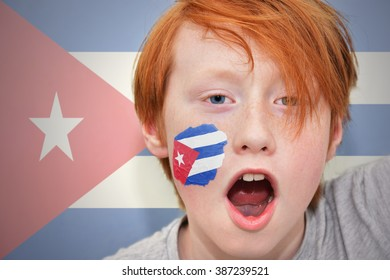 redhead fan boy with cuban flag painted on his face.