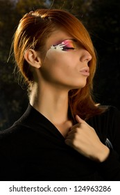 Redhead fashion model with awesome make up