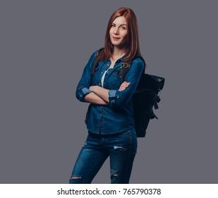 Redhead female in denim shirt.