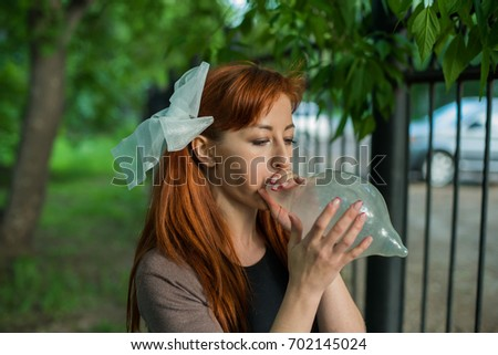 Redhead with condom