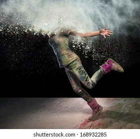 Redhead girl with colored powder exploding around her head and into the background.