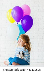 Redhead girl with a puppy cocker spaniel