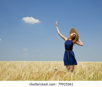 Redhead girl at spring wheat field.