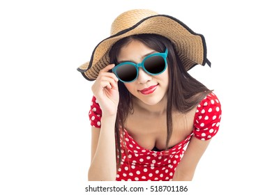 Redhead girl with sunglasses and hat on blue background.