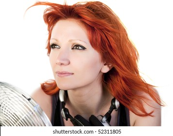 Redhead girl with a ventilator in front