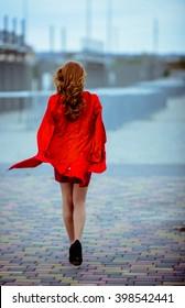 Redhead girl is walking on the heels
