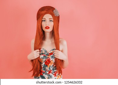 Redhead gorgeous girl with hair style advertising trendy summer clothes on pastel background. Red matte lipstick. Minimal trend. Woman street style. Pastel summer trend. Stylish gorgeous wear