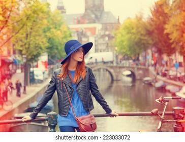 Redhead in hat girl in Amsterdam.