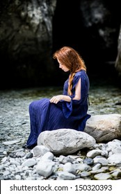 Redhead lady, waiting for her lord with blue medieval dress