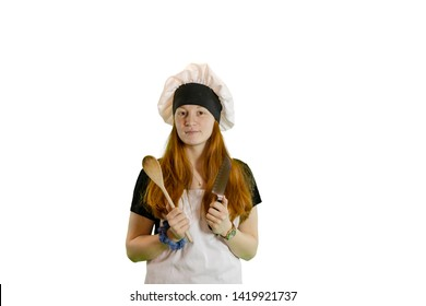 Redhead teen chef with knife and wooden spoon in chef hat and apron isolated on white with copyspace.