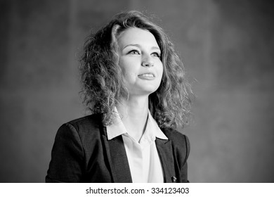 Redhead woman actor in formal grey suit Black and White