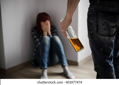 Redhead woman victim of domestic violence abused by drunken husband.