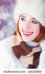 Redhead women on christmas background.