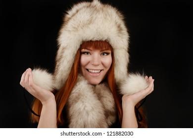 redheaded girl wearing fur hat