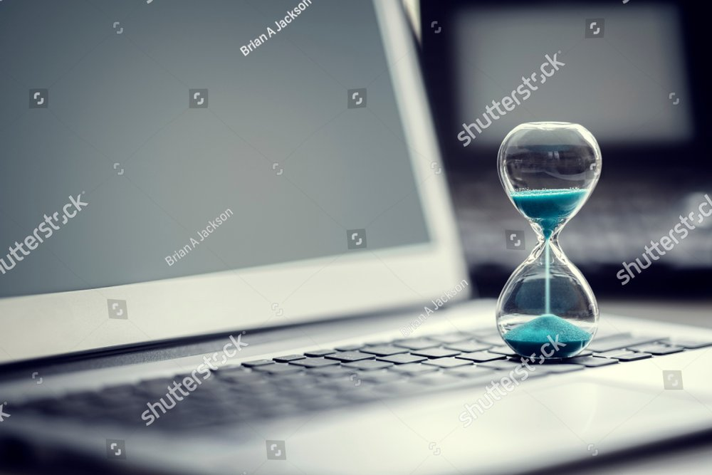Hourglass on laptop computer concept for time management and countdown to deadline