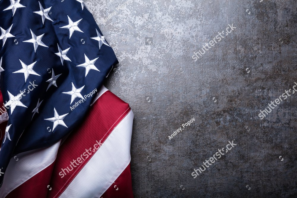 An Overhead View Of American Flag On Dark Concrete Background