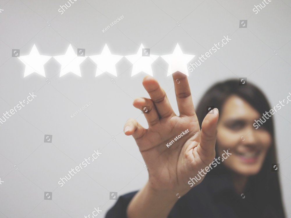 Customer review good rating concept, hand pressing five star on visual screen and  positive customer feedback