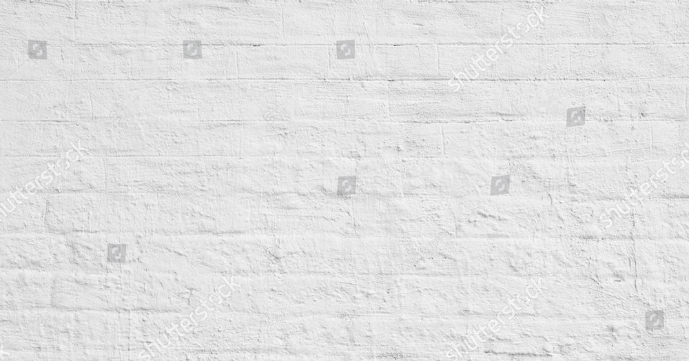 The background of the old white brick wall for design interior and  various scenes or as a background for video interviews.