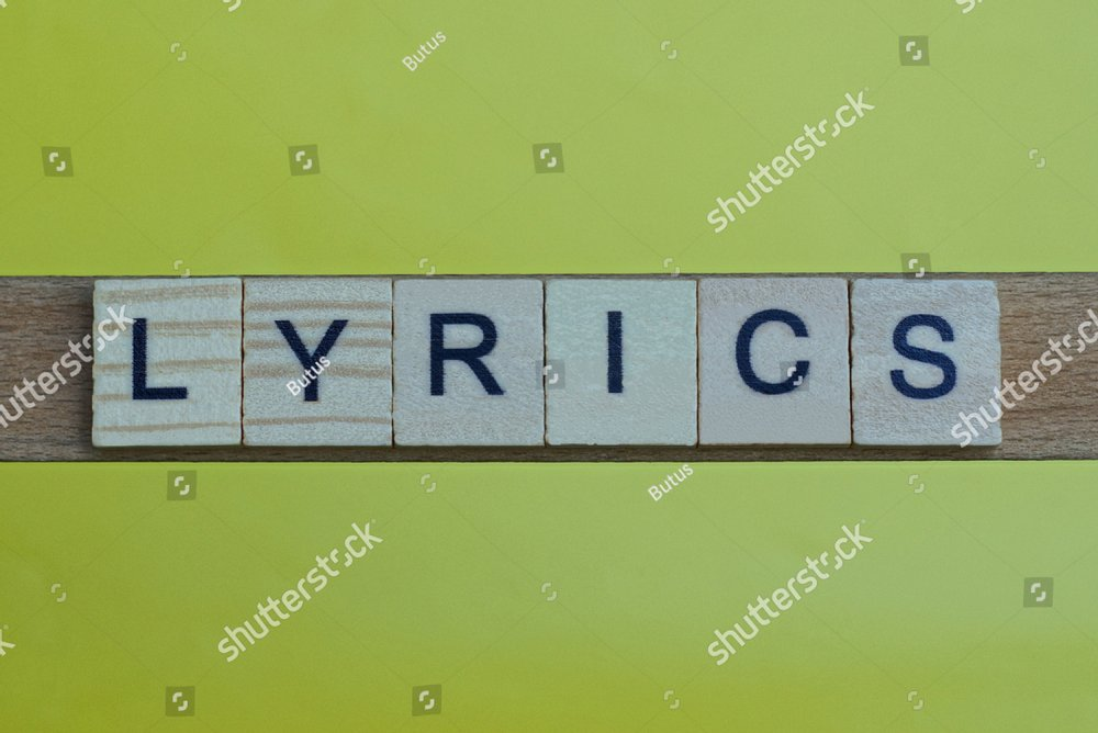 gray word lyrics in small square wooden letters with black font on a yellow background