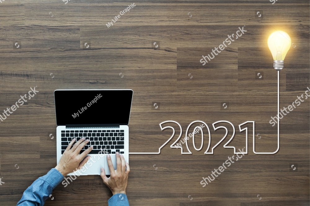 Creative light bulb idea 2021 new year, With businessman working on laptop computer PC, Top view from above