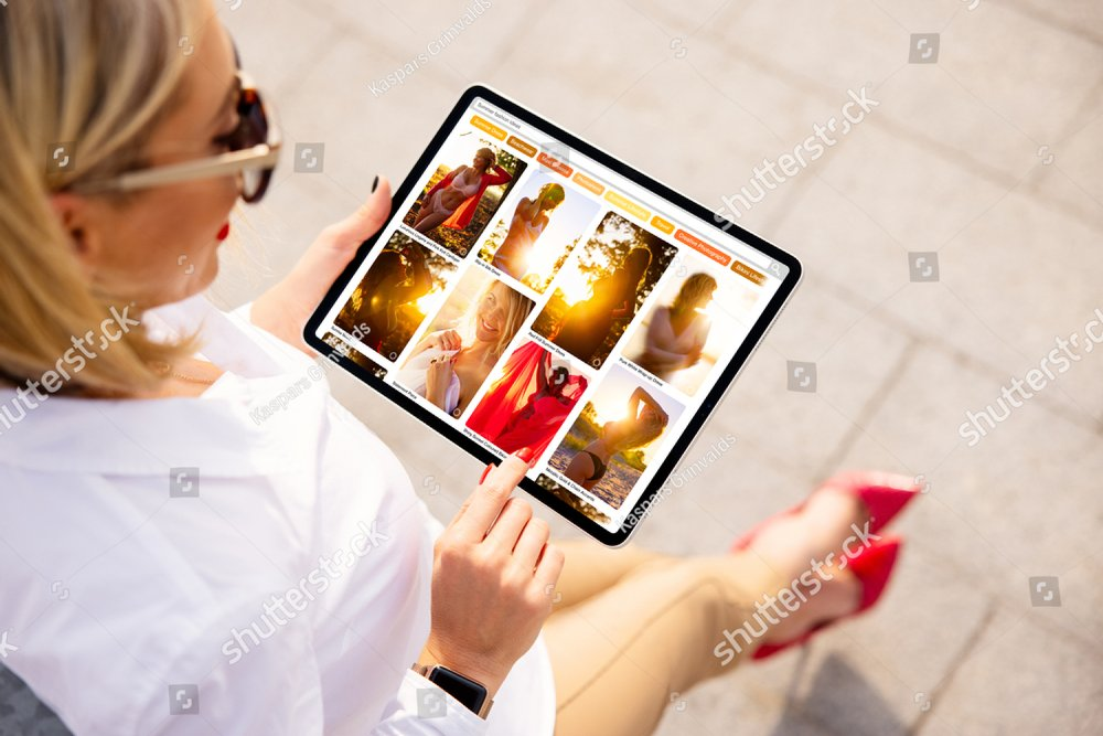 Woman browsing pinned photos online for ideas and inspiration on beautiful fashion photos.