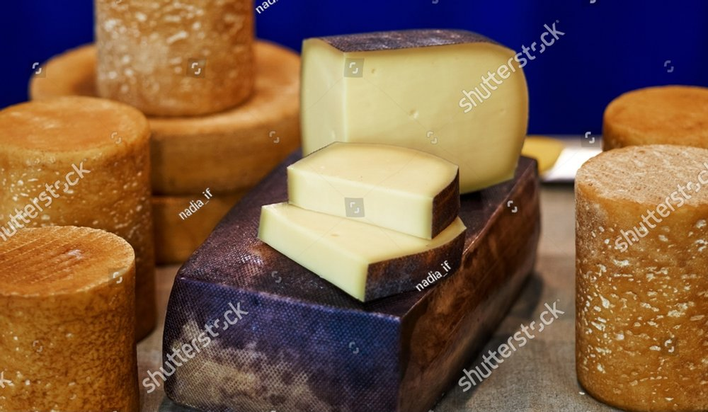 Large selection of cheeses on typical farmer market. Selective focus. High quality photo