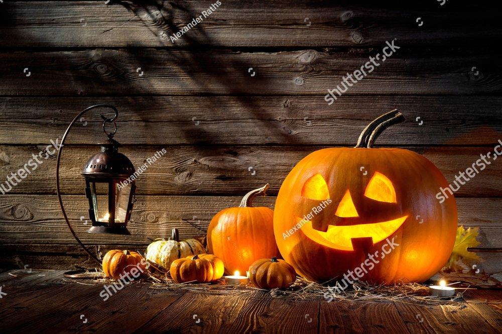 Halloween pumpkin head jack lantern on wooden background
