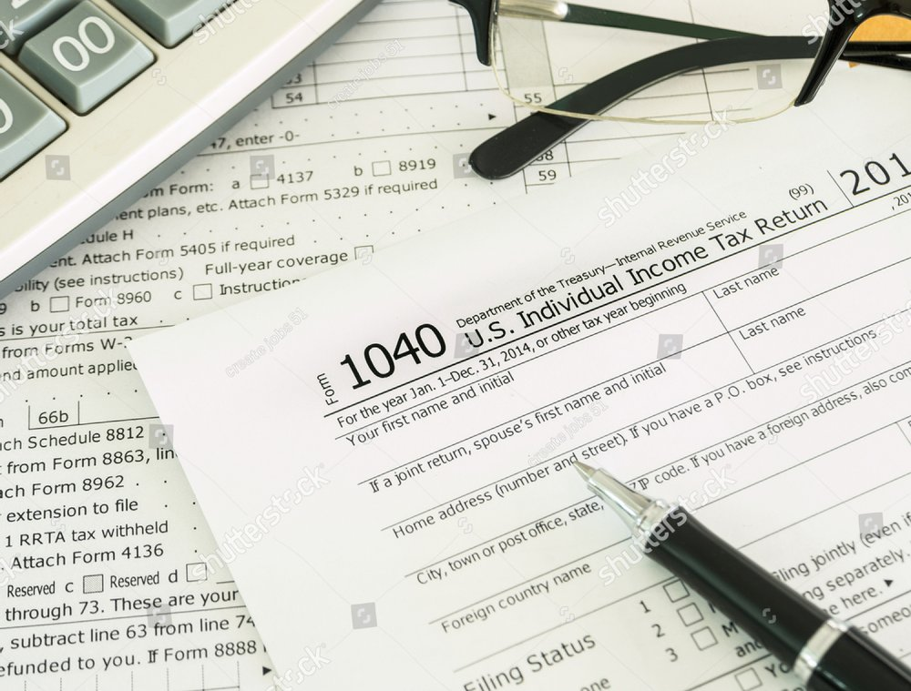 Individual Income Tax Return Form On Desk Ez Canvas