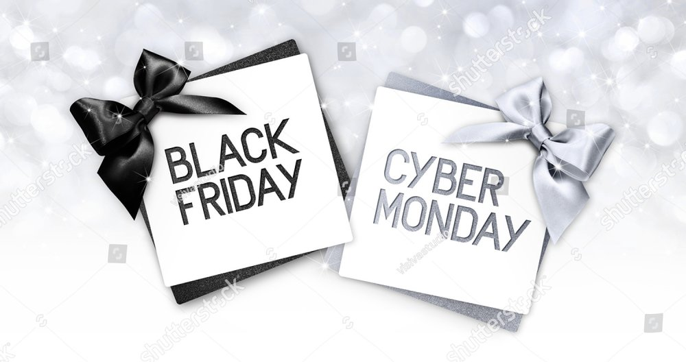 black friday and cyberg monday text write on gift card label with black and silver ribbon bow on blurred bright lights background