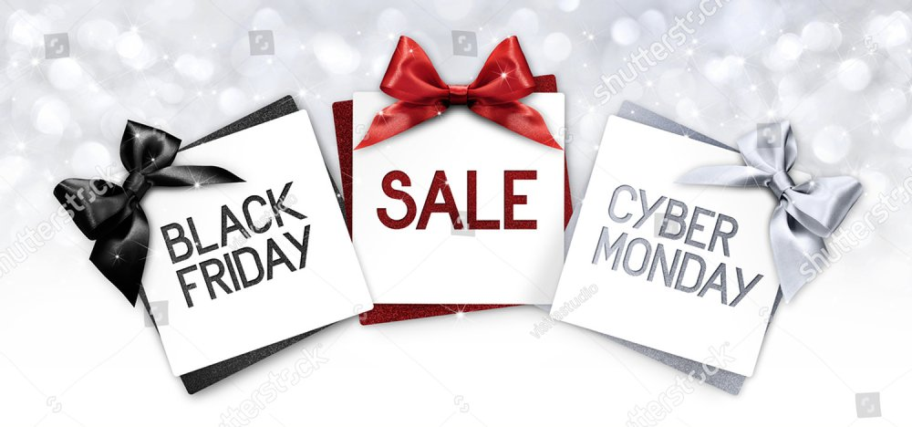 black friday and cyberg monday sale text write on gift card label with black, red and silver ribbon bow on blurred bright lights background