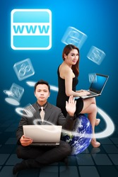 Business man and woman present World Wide Web icon : Elements of this image furnished by NASA