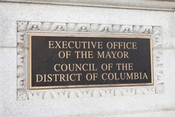WASHINGTON, DC - NOVEMBER 11, 2017: Plaque for the Executive Office of the Mayor and Council of the District of Columbia at the John A. Wilson Building in Washington, DC.