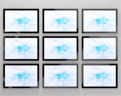 TV Monitors Wall Mounted Representing High Definition Television Or HDTVs