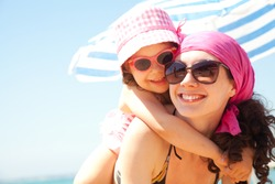 little girl and her mother have  a good time at the seaside resort