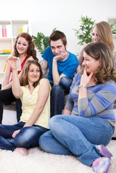 Group of young students having discussion about protection, sex education