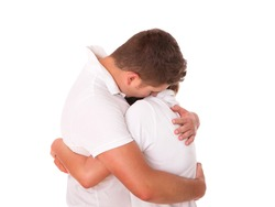 A picture of a young couple hugging over white background
