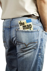 Man standing with travel map in back pocket of denim blue jeans with copy space.