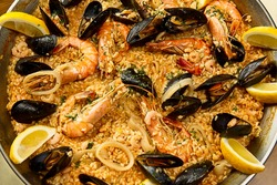 Large portion of paella with seafood
