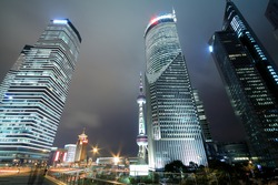 Background night view of Shanghai city modern landmark buildings