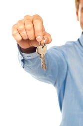 Man holding keys. Focus on keys