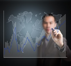 business man writing fluctuate upward trend graph with world map