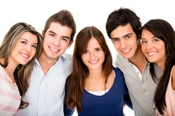 Group of young people smiling - isolated over a white background