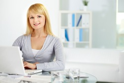 Portrait of a sweet business girl looking at camera and smiling, copy-space provided