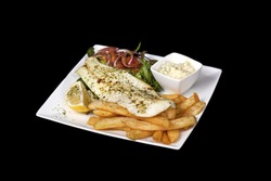 freshly prepared plate of fish and fries