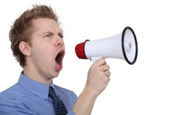 man shouting through a megaphone