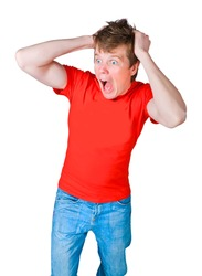 shocked and frightened young man in a red T-shirt