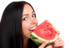 Beautiful young woman eating the water melon